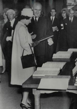 Anthony Lewis presenting Queen Elizabeth II wiTH. a copy of Musica Britannica XIII, 1963, photograph
